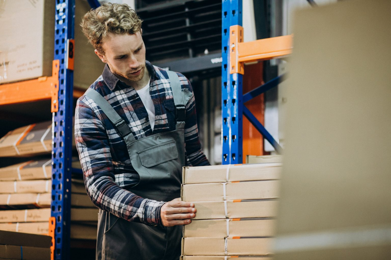 Man working at a carboard factory
